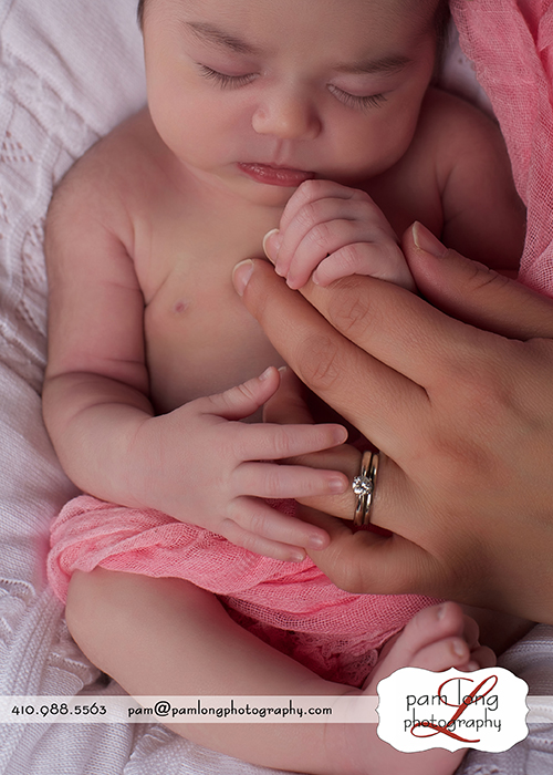 newborn fingers with moms hand Ellicott City newborn photographer